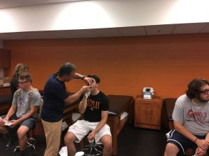 Dr. Allen making mouth guards at Kalamazoo College